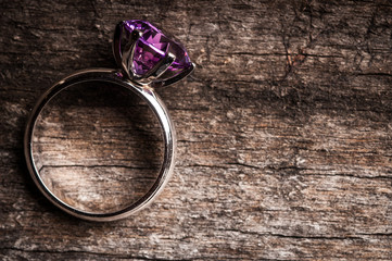 Beautiful engagement ring wooden background