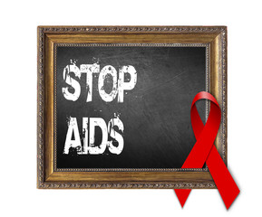 STOP AIDS World Aids Day concept with red ribbon and aids awareness