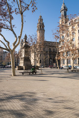 Plaça de Antonio Lopez close to the main street Via Laietana in the Born/La Ribera district of Barcelona. In the background behind the monument the main post office of the Ciutat Vella and Barcelona