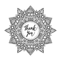 Ornamental greeting card with hand drawn zentangle inspired mandala and thank you text, line art