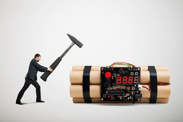 businessman holding big hammer and ready to defusing big bomb