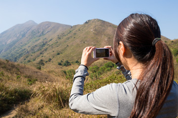 Woman take photo by digital camera