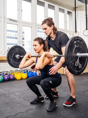 Woman doing squats at crossfit gym