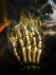 Painting  skull and skeleton hand, on black background and ornamental mandala. Airbrush painting.