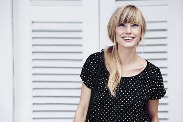 Wall Mural - Beautiful model in black dress, smiling