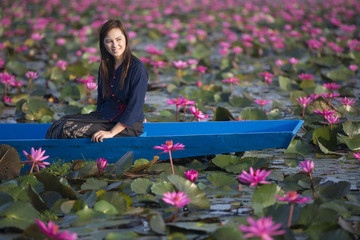 beautiful young woman Farmer collecting pink lotus in garden. thai lifestyle people in local,Thailand
