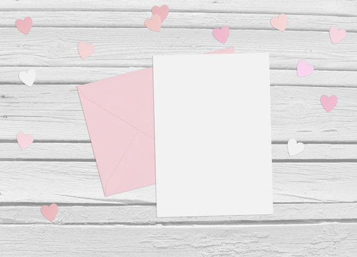Valentines day or wedding mock up scene with paper hearts confetti and old white wooden background