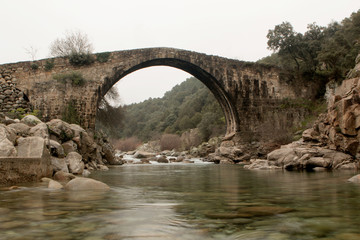 Big bridge with waterfall in Extremadura