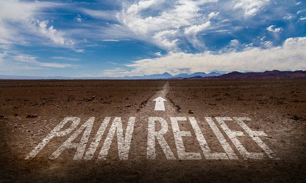 Pain Relief written on desert road