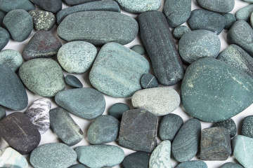 turquoise pebbles on a white background