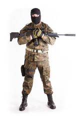 Anti terrorist standing with a gun, studio shot