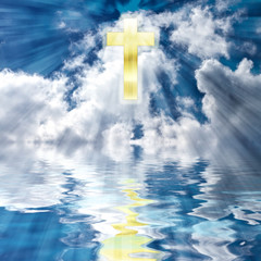 Easter Christian Holiday image of golden cross in the heavens with bursts of lights beams towards water reflecting the cross.  Concept:  He is Risen - Resurrection