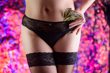Photo of a woman prostitute with dolar banknotes in panties