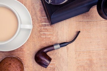 Close-up of coffee and smoking pipe