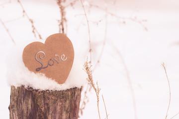 Symbol heart on the log