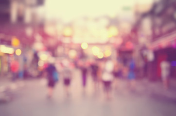 Blur people shopping in local market walking street abstract background.