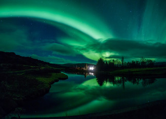 Wall Mural - Aurora borealis reflecting off a lake