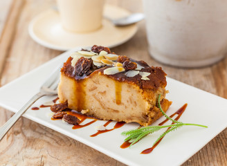 A dessert of bread pudding with caramel sauce