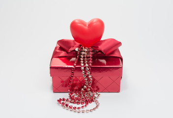 The Holiday - Gift Box with ribbon, bow , red heart, chain of heart on white backgrounds.