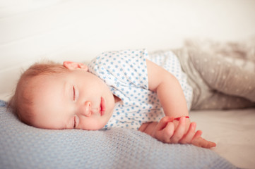 Cute sleeping girl lying in bed closeup. Childhood. Healthy lifestyle.