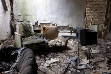 funny, desolte living and TV room in abandoned building