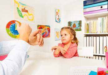 Little preschooler showing bird with her hand