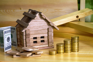 Wooden house block with coins. (finance, property and house loan