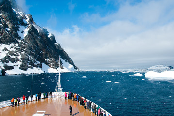 Poster Antarctica Cruise ship in the waters of Antarctica between mountains and ices