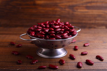 red beans in a metal bowl on a dark wooden background
