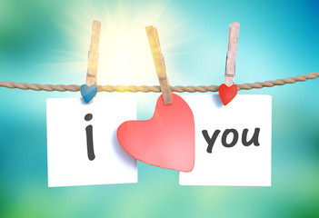 """I love you"" hanging on a rope with clothespins"