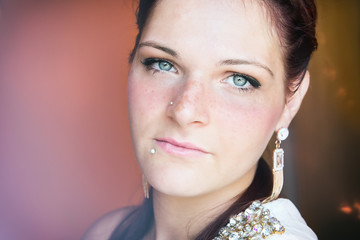portrait of a beautiful girl with blue eyes and piercing
