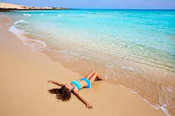 Fototapete - Girl on the beach Fuerteventura at Canary Islands