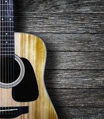 Guitar on wood background.