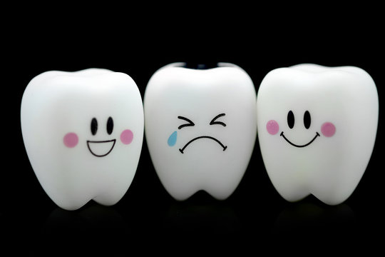 Tooth smile and cry emotion black background.