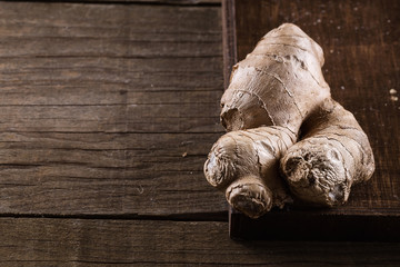 Fresh ginger root on rustic wooden background