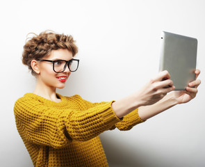 happy woman taking selfie with digital tablet