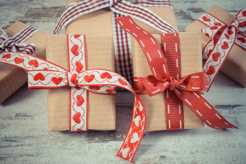 Vintage photo, Wrapped gifts in recycled paper for Valentines or other celebration