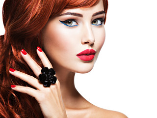 Beautiful sensual woman with long red hair.