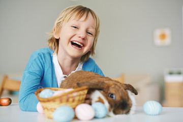 Laughing boy with rabbit