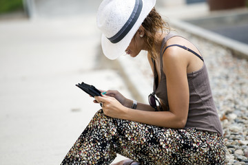 Woman sitting using a tablet