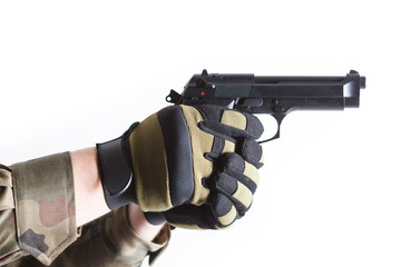 Gloved hands holding a gun