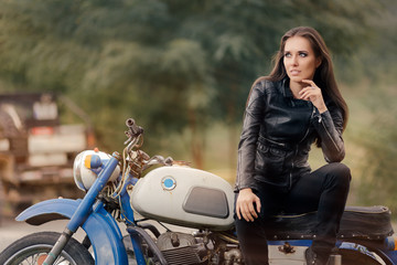 Biker Girl in Leather Jacket on Retro Motorcycle