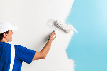 painter painting with paint roller