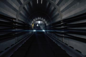 Dark subway tunnel with train