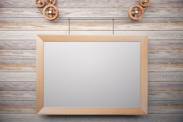 Blank wooden steampunk picture frame on wooden wall, mock up