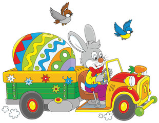 Easter Bunny driving a truck with a big colorfully painted egg