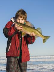 Boy kissing a large Walleye
