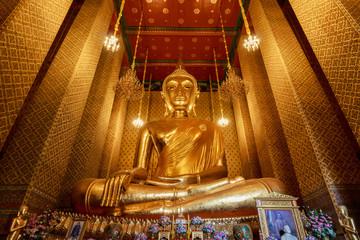 Golden Buddha statue in Thai  Buddhist Temple locally know as Wat Kalayanamitr Varamahavihara , Bangkok Thailand