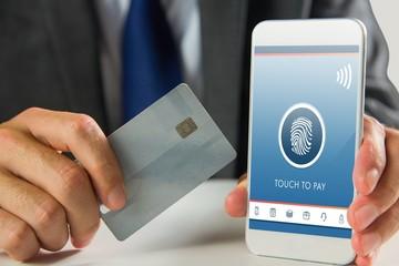 Composite image of businessman using smartphone