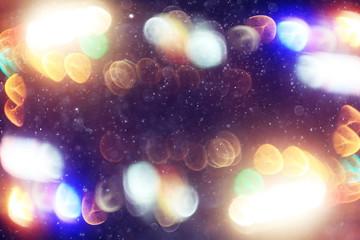 blurred background snow snowfall night lights glass